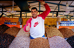 A stallholder in the Jemaa el Fna Marrakech selling nuts, dates and figs. Morocco, North Africa<br /> <br /> (c) Andrew Wilson | Edinburgh Elite media