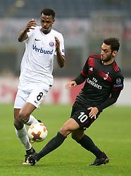 Austria Wien Ibrahim Alhassan Adullahi and AC Milan Hakan Calhanoglu in action