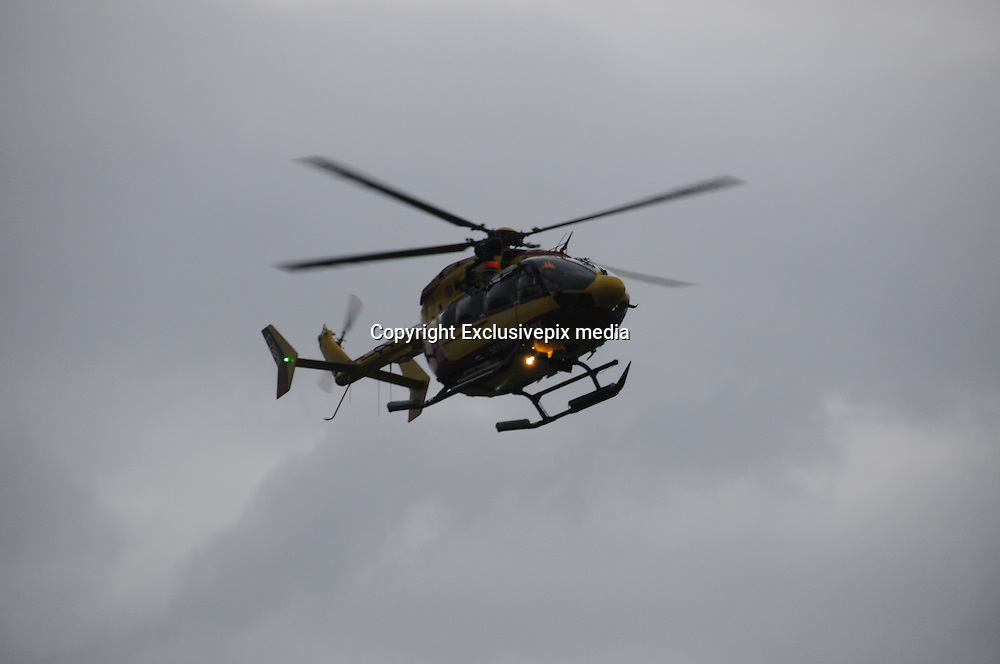 German Plane Crash<br /> Remote access: A rescue helicopter from the French Securite Civile flies towards the French Alps during a rescue operation near the crash site of an Airbus A320, near Seyne-les-Alpes<br /> ©Exclusivepix media