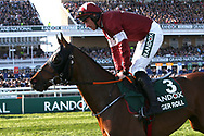 2019 Grand National Winner Tiger Roll and jockey Davy Russell head down to the start for the 5:15pm The Randox Health Grand National Steeple Chase (Grade 3) 4m 2f during the Grand National Meeting at Aintree, Liverpool, United Kingdom on 6 April 2019.