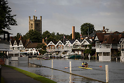 © Licensed to London News Pictures. 09/08/2021. Henley-on-Thames, UK. Rowers train in the early morning ahead of the the Henley Royal Regatta which starts on Wednesday, set on the River Thames by the town of Henley-on-Thames in Oxfordshire, England. Established in 1839, the five day international rowing event, raced over a course of 2,112 meters (1 mile 550 yards), is considered an important part of the English social season. Photo credit: Ben Cawthra/LNP