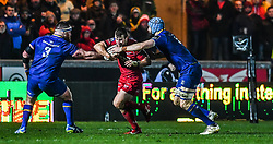 Scarlets' Jonathan Evans is tackled by Leinster's Scott Fardy<br /> <br /> Photographer Craig Thomas/Replay Images<br /> <br /> Guinness PRO14 Round 17 - Scarlets v Leinster - Friday 9th March 2018 - Parc Y Scarlets - Llanelli<br /> <br /> World Copyright © Replay Images . All rights reserved. info@replayimages.co.uk - http://replayimages.co.uk