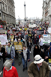 People march through central London as they take part in a protest rally organised by Solidarity with Refugees in a bid to urge the Government to take more action on the migrant crisis.