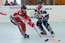 Christoph Draskowitz of Austria vs Jakub Hanka of Slovakia at inline hockey match between Slovakia and Austria at HorjulCup, on June 10, 2011 in Sportni park, Horjul, Slovenia. (Photo by Matic Klansek Velej / Sportida)