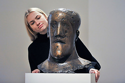 """© Licensed to London News Pictures. 17/11/2017. London, UK.  London, UK.  17 November 2017.  A staff member views """"Head"""", circa 1968, by Dame Elisabeth Frink (Est. GBP 80-120k). Preview upcoming auctions of Modern & Post War British Art and Scottish Art taking place at Sotheby's, New Bond Street, on 21 and 22 November. Photo credit: Stephen Chung/LNP"""