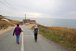 Judith Rhome & Geneviève Martin Preparing For Beach Survey, Looking For Stranded Sea Turtles