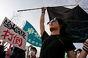 Student activists with Zengakuren (All Japan Federation of Students' Autonomous Body) march at an anti-war and left wing demonstration in Shibuya, Tokyo, Japan  Saturday, March 20th 2010