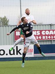 Hibernian's Jordan Forester injured after this jump with Falkirk's Liam Dick.<br /> Falkirk 0 v 3 Hibernian, Scottish Championship game played at The Falkirk Stadium 2/5/2015.