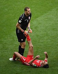MOSCOW, June 23, 2018  Tunisia's goalkeeper Farouk Ben Mustapha (top) helps Saifeddine Khaoui during the 2018 FIFA World Cup Group G match between Belgium and Tunisia in Moscow, Russia, June 23, 2018. (Credit Image: © Wang Yuguo/Xinhua via ZUMA Wire)