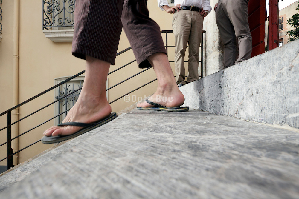 low angle view of person walking down the stairs