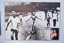Famous War Photograph With Inset of Woman Years Later with Her Child