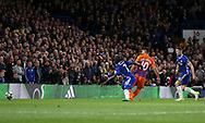 Manchester City's Sergio Aguero scoring his sides opening goal during the Premier League match at the Stamford Bridge Stadium, London. Picture date: April 5th, 2017. Pic credit should read: David Klein/Sportimage