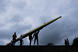 © Licensed to London News Pictures.13/06/15<br /> Durham, England<br /> <br /> A rowing crew walk their boat to the water during the 182nd Durham Regatta rowing event held on the River Wear. The origins of the regatta date back  to commemorations marking victory at the Battle of Waterloo in 1815. This is the second oldest event of this type in the country and attracts over 2000 competitors from across the country.<br /> <br /> Photo credit : Ian Forsyth/LNP