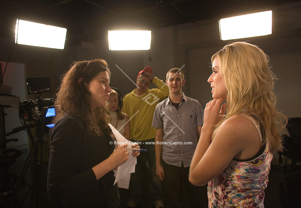 """Producers Susan Warner, Kate Susman, Jim Garvey, Jared Heinke, and host Maria Sansone tapes the Friday, Oct. 20 episode of Yahoo!'s """"The 9"""" in their New York studio."""