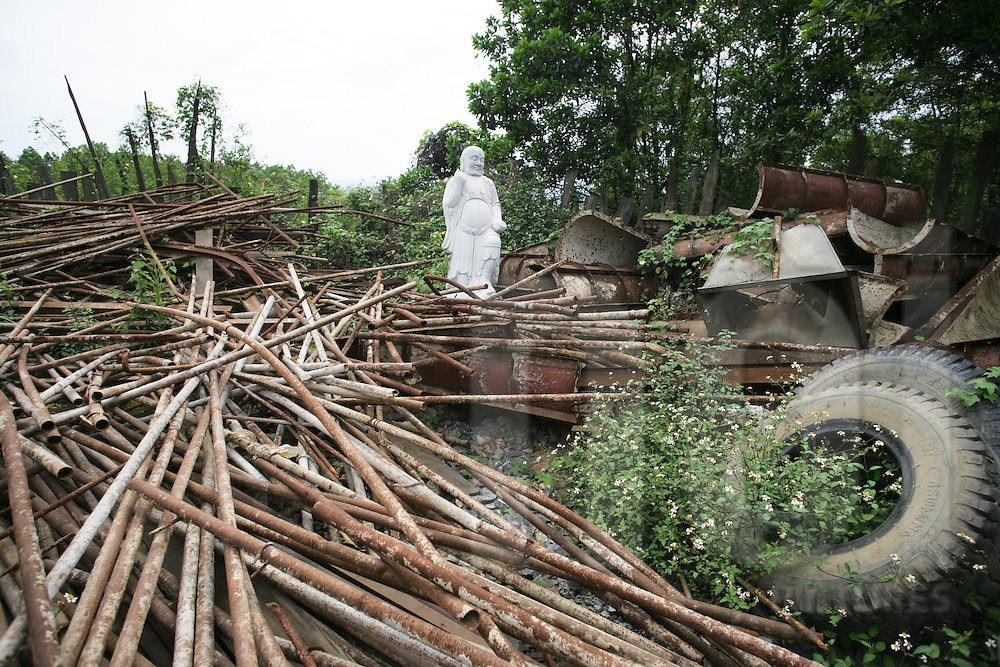 Abandoned Buddha statue in Ninh Binh, surrounded by metal scraps near Bai Dinh Pagoda, the largest pagoda in northern Vietnam, Southeast Asia