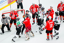 Goalkeeper Jure Pavlic of Jesenice in fight with Pascal Morency of Olimpija during ice hockey game between Team Jesenice and HDD Telemach Olimpija in 1st leg of Finals of Slovenian National Championship 2014, on March 31, 2014 in Arena Podmezakla, Jesenice, Slovenia. Photo by Vid Ponikvar / Sportida