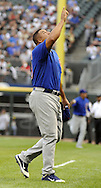 CHICAGO - JUNE 20:  Carlos Zambrano #38 of the Chicago Cubs points toward the sky while walking off the mound in the first inning of the game against the Chicago White Sox on June 20, 2011 at U.S. Cellular Field in Chicago, Illinois.  The Cubs defeated the White Sox 6-3.  (Photo by Ron Vesely)  Subject:  Carlos Zambrano