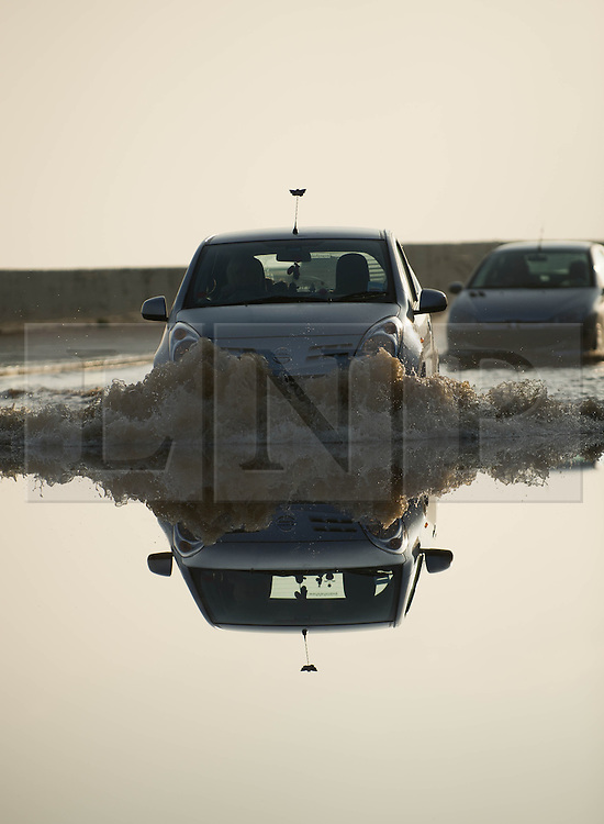 © Licensed to London News Pictures. 07/09/2013<br /> <br /> Saltburn, Cleveland, England<br /> <br /> A driver makes her way trough a heavily flooded road following an evening of torrential rainfall that caused flooding and disruption to Saltburn in Cleveland.<br /> <br /> Photo credit : Ian Forsyth/LNP