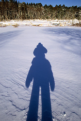 Shadow Of Person In Field Of Snow