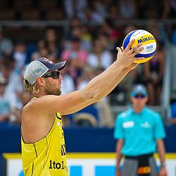 10-07-2011 VOLLEYBAL: FIVB WORLD TOUR BEACHVOLLEYBAL: GSTAAD<br /> Julius Brink GER<br /> ©2011-www.FotoHoogendoorn.nl / Peter Schalk