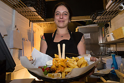 Manager Arianna Bonesso serves up a plate of vegan scampi and chips at London's first totally vegan chippy in Hackney, North East London. Hackney, London, October 08 2018.