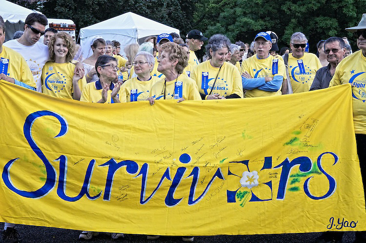 Cancer survivors gather to participate in the Survivor's Lap during the Relay for Life 2010 Central Toronto.