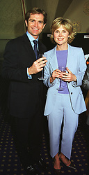 MR GRANT BOVEY and TV presenter ANTHEA TURNER, at a reception in London on 20th May 1999.MSH 16