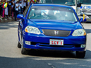 27 NOVEMBER 2017 - YANGON, MYANMAR: The Pope waves from his car as he drives past Myanmar Catholics on his way into Yangon. Pope Francis arrived in Yangon Monday for a four day / three night visit. Tuesday he is going to the capitol, Naypyidaw (Nay Pyi Taw) to meet with Aung San Suu Kyi and other Myanmar leaders. Wednesday and Thursday he is saying mass in Yangon and on Thursday afternoon he is going to neighboring Bangladesh. There are around 450,000 Catholics in Burma, about 1% of the total population.   PHOTO BY JACK KURTZ