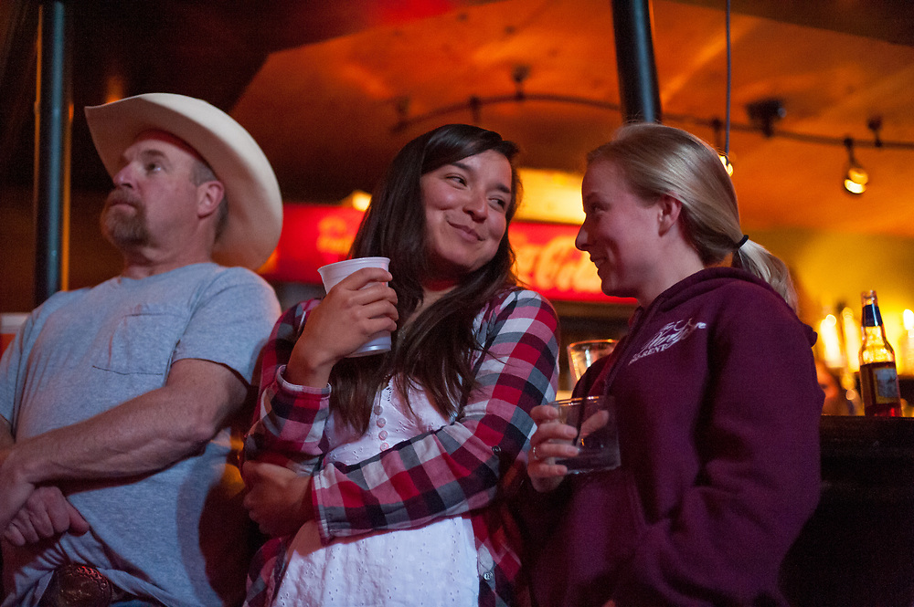Erin Henry (center), who is brought supplies by Chuck and Andy in a forest service fire lookout in Dead End Express.