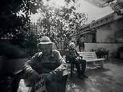 Mrs. Teresa and Mr. Manel rest in the courtyard of the Centro Geriàtric Gure Etxea of Barcelona , Spain on april 24, 2020. Coverage of the COVID-19 pandemic in Barcelona , Spain. NopoLF large-format pinhole camera