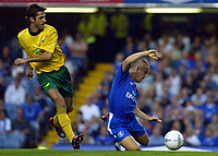 Photograph: Scott Heavey.<br />Chelsea v MSK Zilina, Champions League qualifier, second leg from Stamford Bridge. 26/08/2003.<br />Joe Cole goes down after a shove by Martin Durica.