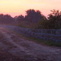 Razor wire border fence between Hungary and Serbia near Roszke (about 174 km South of capital city Budapest), Hungary on August 30, 2015. ATTILA VOLGYI