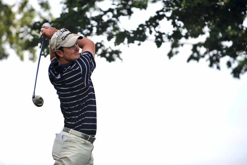Justin Rose tees off the ninth hole during the third round of the Travelers Championship golf tournament on Saturday, June 26, 2010, in Cromwell, Conn. (AP Photo/Jessica Hill)