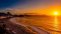 Sunrise view over Avenida Atlantica and Copacabana Beach, with Sugarloaf Mountain in background, Rio de Janiero, Brazil.