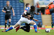 Fejiri Okenabirhie of Doncaster Rovers is fouled by Joseph Rankin-Costello of Blackburn Rovers during the EFL Cup match between Blackburn Rovers and Doncaster Rovers at Ewood Park, Blackburn, England on 29 August 2020.
