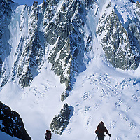 Ski mountaineers climb the Chardonnet Glacier on the classic Haute Route ski tour through the Alps from Chamonix, France, to Zermatt, Switzerland.  Aiguille Verte (4121m) is in the background .