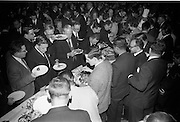 """25/03/1966<br /> 03/25/1966<br /> 25 March 1966<br /> Shock Symposium at UCD, Belfield, Dublin. The symposium on medical """"Shock"""" sponsored by Pharmacia International was held at the Department of Science at U.C.D.. Over 250 attended the symposium that was presided over by Prof. P. FitzGerald M.D., M.Ch., M.Sc F.R.C.S.I.. Picture shows a general view of the attendance at the """"smorgasbord"""" at the event."""