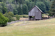 This heritage barn was constructed in 1935 on Daniel Henry Ruckle's farm.  It currently is used for hay and machinery storage. Photographed in Ruckle Provincial Park on Saltspring Island, British Columbia, Canada.