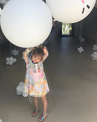 """Kourtney Kardashian releases a photo on Instagram with the following caption: """"I can not believe my baby girl is 5 years old today \ud83d\ude2d Happy Birthday my sweet angel. I feel so blessed to be her mommy every morning that I wake up next to her."""". Photo Credit: Instagram *** No USA Distribution *** For Editorial Use Only *** Not to be Published in Books or Photo Books ***  Please note: Fees charged by the agency are for the agency's services only, and do not, nor are they intended to, convey to the user any ownership of Copyright or License in the material. The agency does not claim any ownership including but not limited to Copyright or License in the attached material. By publishing this material you expressly agree to indemnify and to hold the agency and its directors, shareholders and employees harmless from any loss, claims, damages, demands, expenses (including legal fees), or any causes of action or allegation against the agency arising out of or connected in any way with publication of the material."""