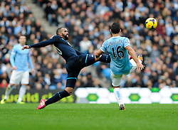 Manchester City's Sergio Aguero wins the ball from Tottenham Hotspur's Sandro - Photo mandatory by-line: Dougie Allward/JMP - Tel: Mobile: 07966 386802 24/11/2013 - SPORT - Football - Manchester - Etihad Stadium - Manchester City v Tottenham Hotspur - Barclays Premier League