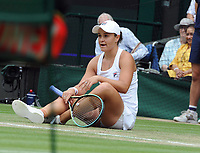 Lawn Tennis - 2021 All England Championships - Week Two - Thursday - Wimbledon - Ladies Semi Final . Ashleigh Barty v Angelique Kerber <br /> <br /> Ashleigh Barty of Australia slips on the grass<br /> <br /> Credit : COLORSPORT/Andrew Cowie