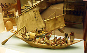 Model of military boat found in an Egyptian tomb at Beni  Hasaan 9th -11th Dynasty, 2160 to 2025 BC. Two crew members are shown playing senet.
