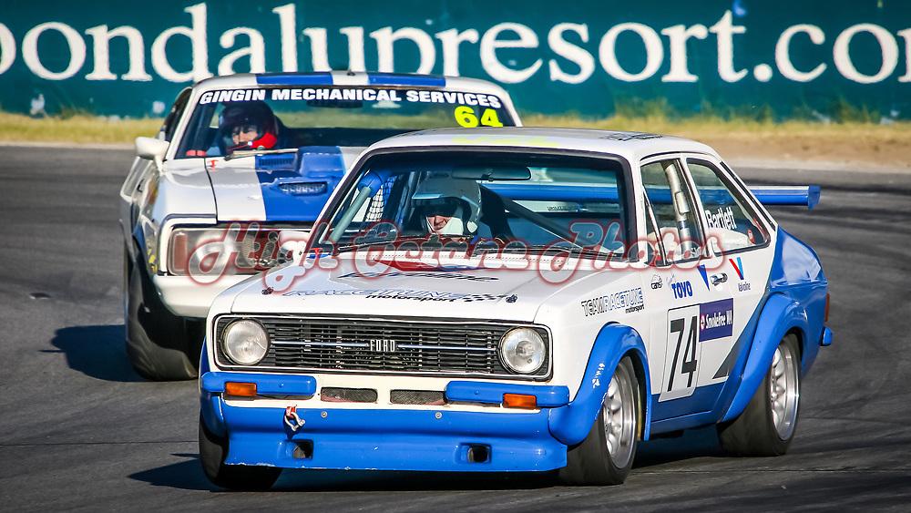 David Bartlett (74 - Ford Escort MKII) leads Glen Brocklehurst (64 - Ford Falcon) onto the main straight at Wanneroo Raceway