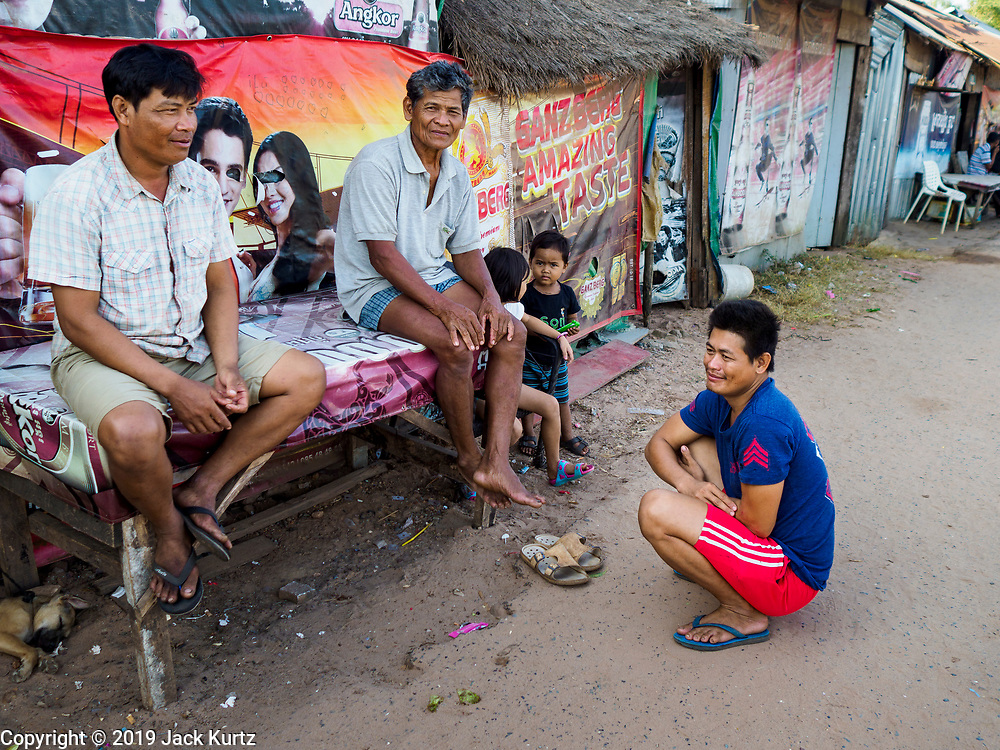"""15 FEBRUARY 2019 - SIHANOUKVILLE, CAMBODIA:  Cambodian men who live in a migrant camp in Sihanoukville. They came to Sihanoukville because of the town's booming economy. He said he came hoping to get work in the contruction industry. There are about 80 Chinese casinos and resort hotels open in Sihanoukville and dozens more under construction. The casinos are changing the city, once a sleepy port on Southeast Asia's """"backpacker trail"""" into a booming city. The change is coming with a cost though. Many Cambodian residents of Sihanoukville  have lost their homes to make way for the casinos and the jobs are going to Chinese workers, brought in to build casinos and work in the casinos.      PHOTO BY JACK KURTZ"""