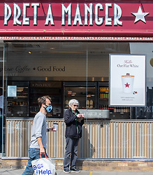 © Licensed to London News Pictures. 16/04/2020. London, UK. A man buys a takeaway coffee from Pret A Manger in St John's Wood, London which has reopened as Ministers decide when and how the lockdown will finish as politicians are warned that the UK could face the worst recession in 300 years. Photo credit: Alex Lentati/LNP