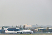 """A plane of """"China Eastern"""" airline is seen landing in Heathrow Airport in London on Wednesday, April 8, 2020 - after the Chinese authorities have announced that they will increase the number of temporary flights to the UK on April 2 to facilitate the return of overseas students who have difficulties to return home. Worried oversea students have rushed to flee the coronavirus pandemic after schools across Europe closed campuses and moved classes online to contain the spread of the virus. (Photo/Vudi Xhymshiti)"""