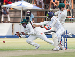 Zimbabwe slip fielder Hamilton Masakdza attempts a catch during the 100th test match played by Zimbabwe in a match with Sri Lanka at Harare Sports Club 29 October 2016.