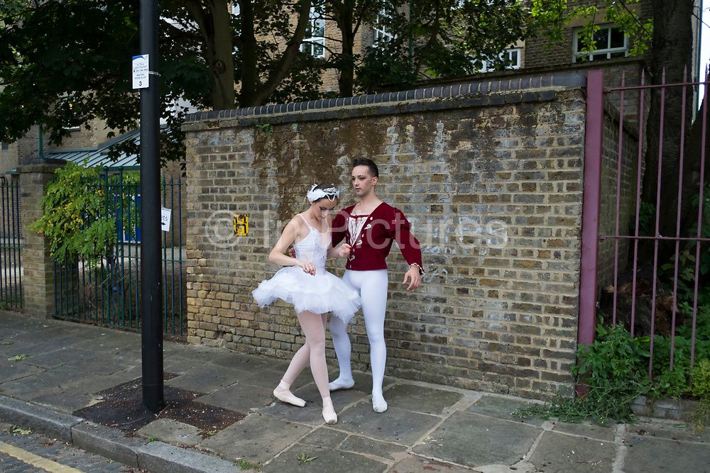 Ballet dancers from the Ruggieri Dance Academy practice their positions in an unexpected urban environment prior to a performance at a local Summer event in Wapping, London, England, United Kingdom. (photo by Mike Kemp/In Pictures via Getty Images)