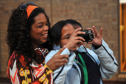 5144<br /> 09.6.17<br /> Oprah Winfrey enjoys a student's pictures after having visited a class during Oprah Winfrey Leadership Academy for Girls' Arts Workshop week, during which the students were given a taste of a variety of disciplines in the arts. The school in Henley-On-Klip, has about 300 pupils from disadvantaged backgrounds, all of whom have shown academic promise.<br /> Picture: Cara Viereckl