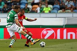 August 15, 2017 - Lisbon, Portugal - Steaua's forward Denis Alibec (R ) vies with Sporting's defender Sebastian Coates from Uruguay during the UEFA Champions League play-offs first leg football match between Sporting CP and FC Steaua Bucuresti at the Alvalade stadium in Lisbon, Portugal on August 15, 2017. Photo: Pedro Fiuza (Credit Image: © Pedro Fiuza via ZUMA Wire)